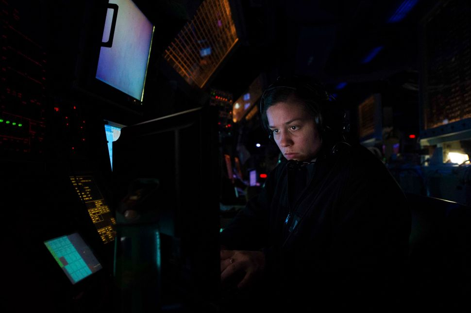 Lt. j.g. Lisa Schmidt stands the tango charlie watch in the combat information center aboard the Arleigh Burke-class guided-m