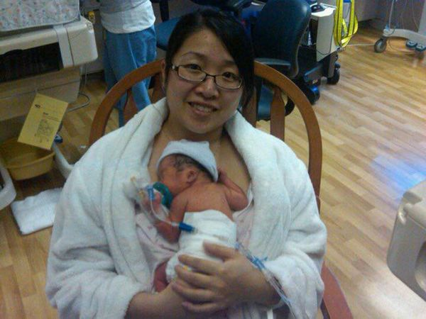 """""""Born at 31 and a half weeks, this was the very first time I held my baby girl. I was so scared because she was so tiny and h"""