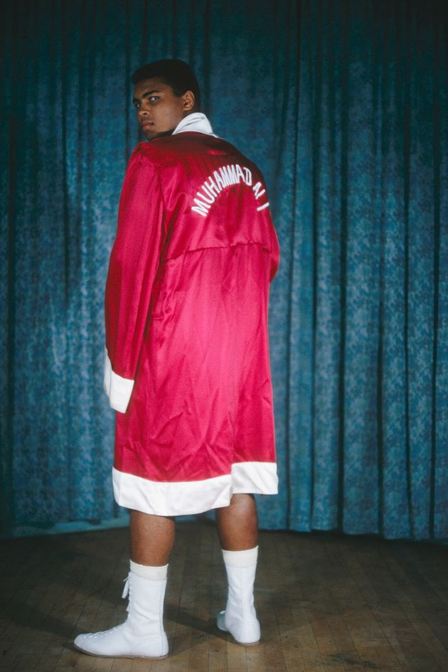 Muhammad Ali poses for a portrait in his robe in