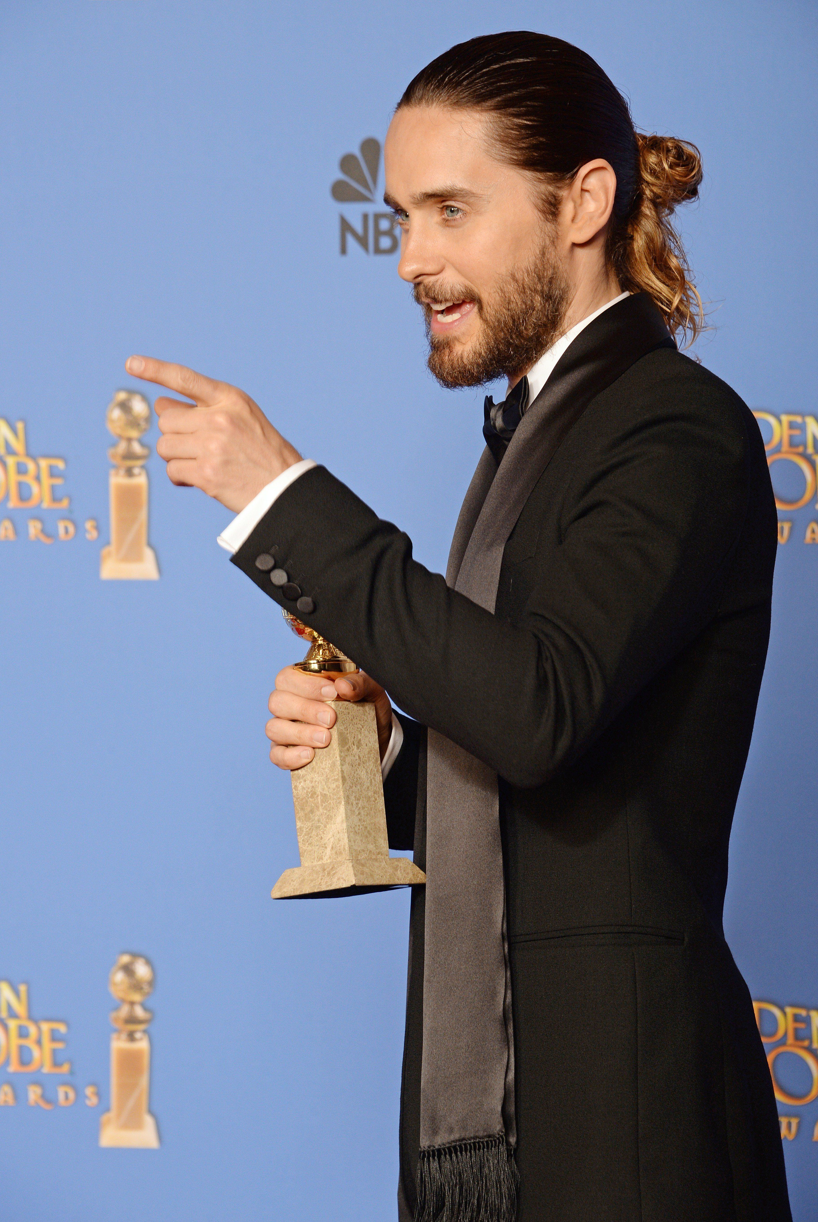 Actor Jared Leto, winner of the Best Supporting Actor in a Motion Picture - Drama, Musical or Comedy award for 'Dallas Buyers Club,' poses in the press room at the 71st Annual Golden Globe Awards in Beverly Hills, California, January 12, 2014. AFP PHOTO / ROBYN BECK        (Photo credit should read ROBYN BECK/AFP/Getty Images)