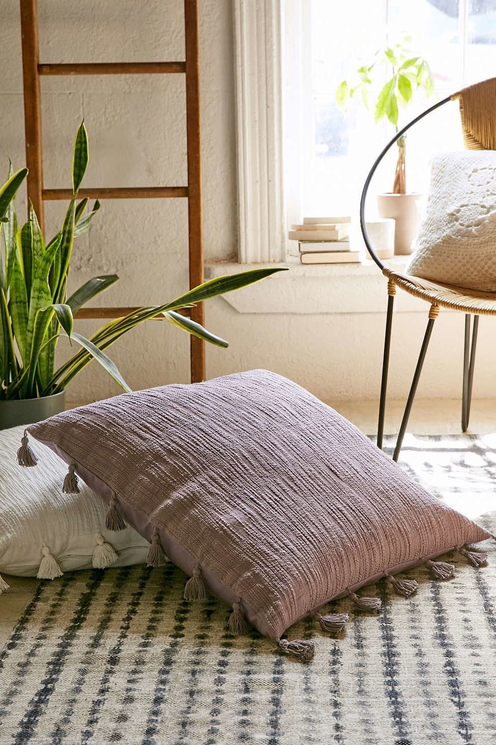12 oversized throw pillows are great to nestle against during a netflix binge