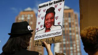 A woman holds a poster bearing the portrait of  Sandra Bland, a 28-year-old black woman who killed herself in a Texas jail cell on July 13th,   during a Michael Brown memorial rally on Union Square August 9, 2015 in New York.  Demonstrators showed support on the one year anniversary  on the death of 18-year-old Michael Brown, an unarmed black teen who was shot and killed in Ferguson, Missouri by a white police officer, Darren Wilson, throwing America's troubled race relations into harsh relief.     AFP PHOTO / KENA BETANCUR        (Photo credit should read KENA BETANCUR/AFP/Getty Images)