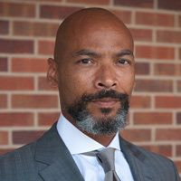 Chuck Henson is a law professor who will now lead the university's diversity efforts.