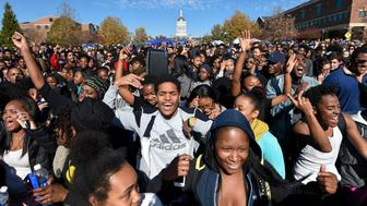 Student protesters on the campus of the University of Missouri in Columbia react to news of the resignation of University of Missouri system President Tim Wolfe on Monday, Nov. 9, 2015. Wolfe resigned under pressure from student protesters who claimed the president had not done enough to address recent racially-motivated incidents on the campus. (David Eulitt/Kansas City Star/TNS via Getty Images)