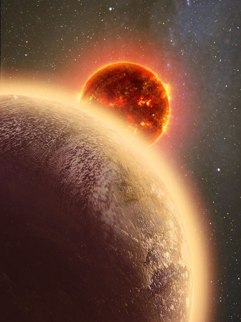 In this artist's conception GJ 1132b, a rocky exoplanet very similar to Earth in size and mass, circles a red dwarf star. GJ 1132b is relatively cool, about 450 degrees F, and could potentially host an atmosphere. At a distance of only 39 light-years, it will be a prime target for additional study with Hubble and future observatories like the Giant Magellan Telescope.