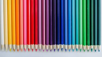 26 colored pencis arrenged like a rainbow - view from above