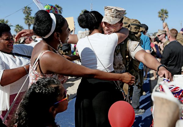Sgt. Obie Dubose gets hugs from his family during a homecoming for Marines from the 13th MEU on April 24, 2014, in Camp Pendl