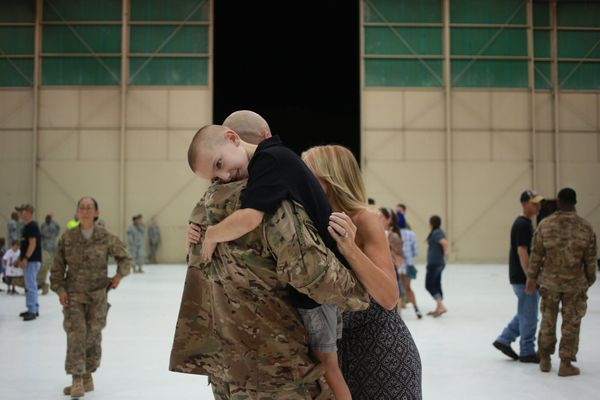 Bradyn Vest embraces his father, Sgt. 1st Class Kevin Vest of the U.S. Army's 159th Combat Aviation Brigade, 101st Airborne D
