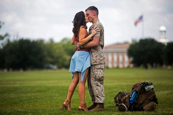 Lance Cpl. David Sellers, a refrigeration mechanic with the 24th Marine Expeditionary Unit, embraces his wife with a kiss dur