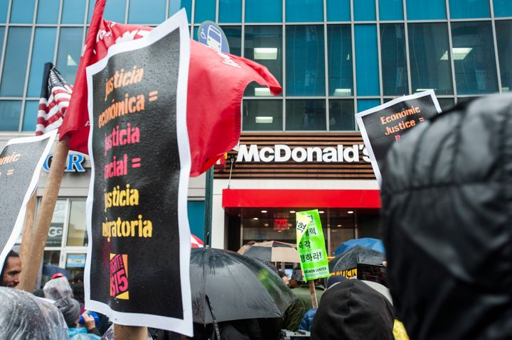 New York City workers protest outside a McDonald's in Harlem on Tuesday.