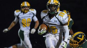 GERMANTOWN, MD - OCTOBER 30: Damascus wide receiver Markus Vinson runs the ball into the end zone for a touchdown during the game at Seneca Valley on Friday, October 30, 2015.  Damascus defeated Seneca Valley 21-3 and remains unbeaten this season. (Photo by Toni L. Sandys/ The Washington Post via Getty Images)