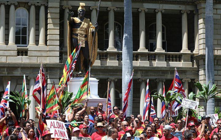 Mauna Kea demonstrators group around the King Kamehameha statue in Honolulu.