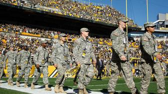 PITTSBURGH, PA - NOVEMBER 08:  Members of the United States Armed Forces spend a moment on the field at Heinz Field before the start of the 'Salute to Service' game between the Pittsburgh Steelers and Oakland Raiders on November 8, 2015 in Pittsburgh, Pennsylvania.  (Photo by Justin K. Aller/Getty Images)