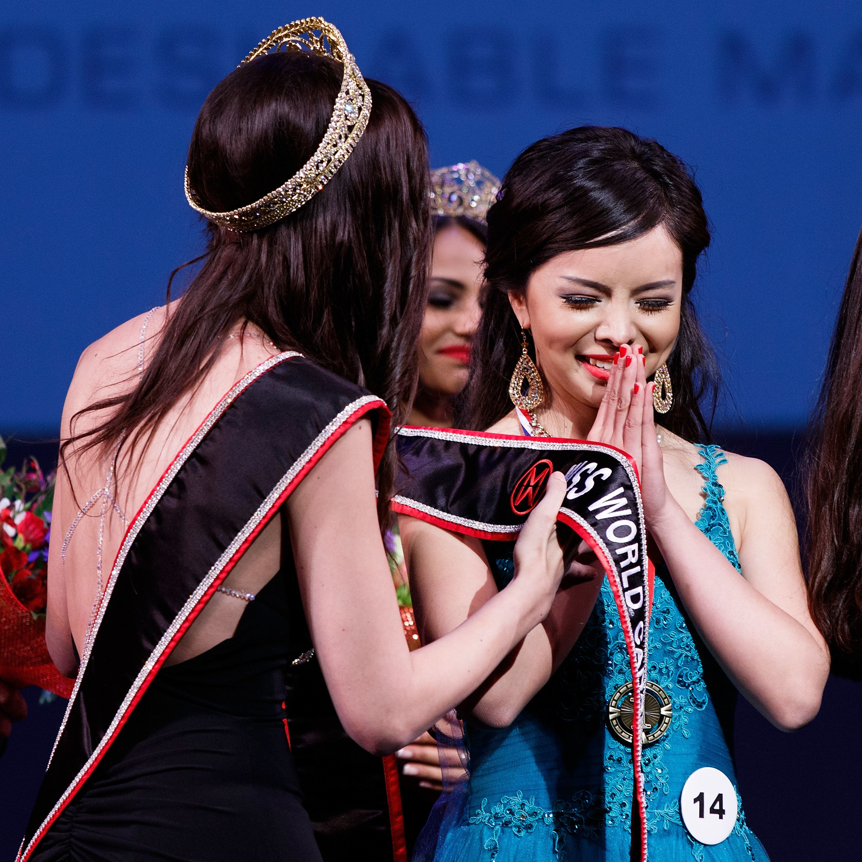 VANCOUVER, BC - MAY 16:  Anastasia Lin (R) is crowned Miss World Canada 2015 by Former Miss World Canada 2014 Annora Bourgeault (L) during Miss World Canada 2015 pageant competition at The Queen Elizabeth Theatre on May 16, 2015 in Vancouver, Canada.  (Photo by Andrew Chin/Getty Images)