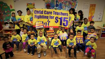 Child care workers and children at Ubuntu Academy and Early Learning Center in Kansas City, Missouri.