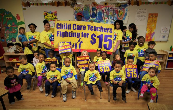 Child care workers and children at Ubuntu Academy and Early Learning Center in Kansas City, Missouri, call for a $15 per hour