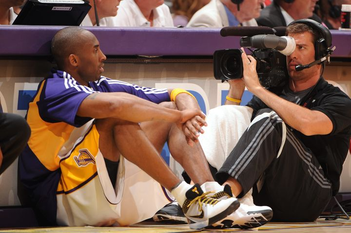 A camera man gets a close-up of Bryant as he waits to entera Lakers home game.