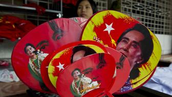 Various fans with portraits of Myanmar opposition leader Aung San Suu Kyi are seen for sale outside the National League for Democracy (NLD) party headquarters in Yangon on November 11, 2015. Aung San Suu Kyi's opposition appeared on the verge of a landslide election win that could finally reset Myanmar after decades of army control, as a top member of the ruling party said they had 'lost completely'.   AFP PHOTO / ROMEO GACAD        (Photo credit should read ROMEO GACAD/AFP/Getty Images)