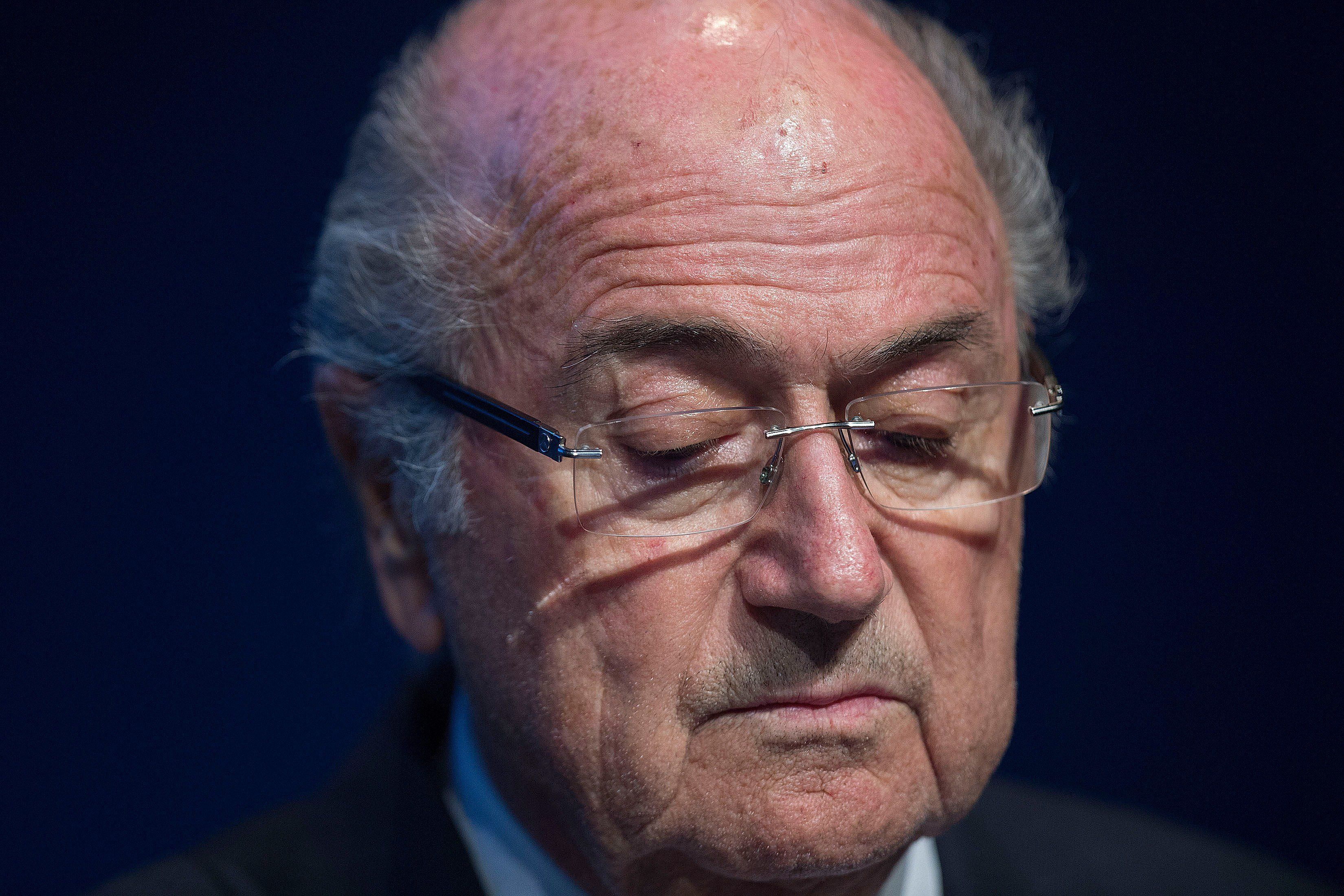 FIFA President Sepp Blatter looks down during a press conference at the headquarters of the world's football governing body in Zurich on June 2, 2015. Blatter resigned as president of FIFA as a mounting corruption scandal engulfed world football's governing body. The 79-year-old Swiss official, FIFA president for 17 years and only reelected days ago, said a special congress would be called to elect a successor. AFP PHOTO / VALERIANO DI DOMENICO        (Photo credit should read VALERIANO DI DOMENICO/AFP/Getty Images)