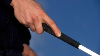 Correct way for blind person to hold long white cane, UK. (Photo by: Photofusion/UIG via Getty Images)