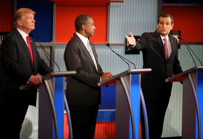 Republican presidential candidate Ben Carson (C) looks on as Sen. Ted Cruz (R-Texas) speaks during the Republican Presidentia