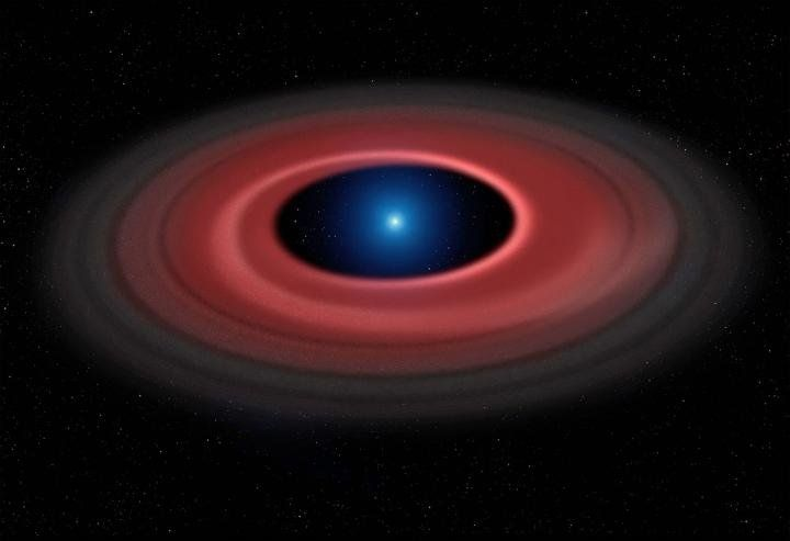This artist's impression shows how an asteroid torn apart by the strong gravity of a white dwarf has formed a ring of dust particles and debris orbiting the Earth-sized burnt out stellar core SDSS J1228 1040. Gas produced by collisions within the disc is detected in observations obtained over twelve years with ESO's Very Large Telescope, and reveal a narrow glowing arc.