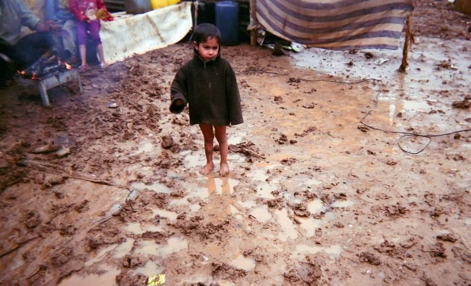 Shot by Moustafa, age 12, from Hama Governorate, Syria.<strong><br></strong> A young boy who is wearing neither pants no