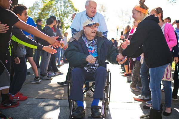 Anthony Petruzzi, 92, a veteran of World War II, Korea, and Vietnam is greeted as he arrives with an Honor Fight group from K