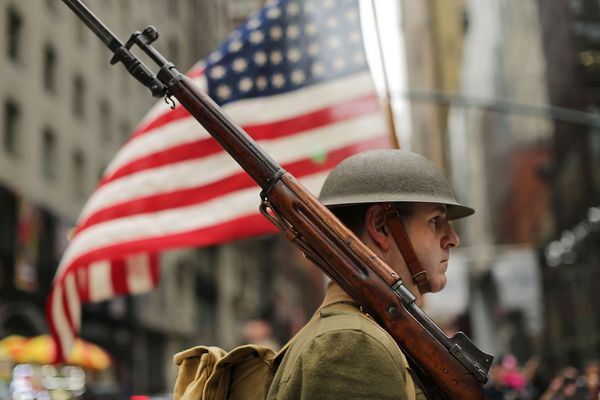 A World War I army reinactor marches in the nation's largest Veterans Day Parade in New York City on in New York City. Known