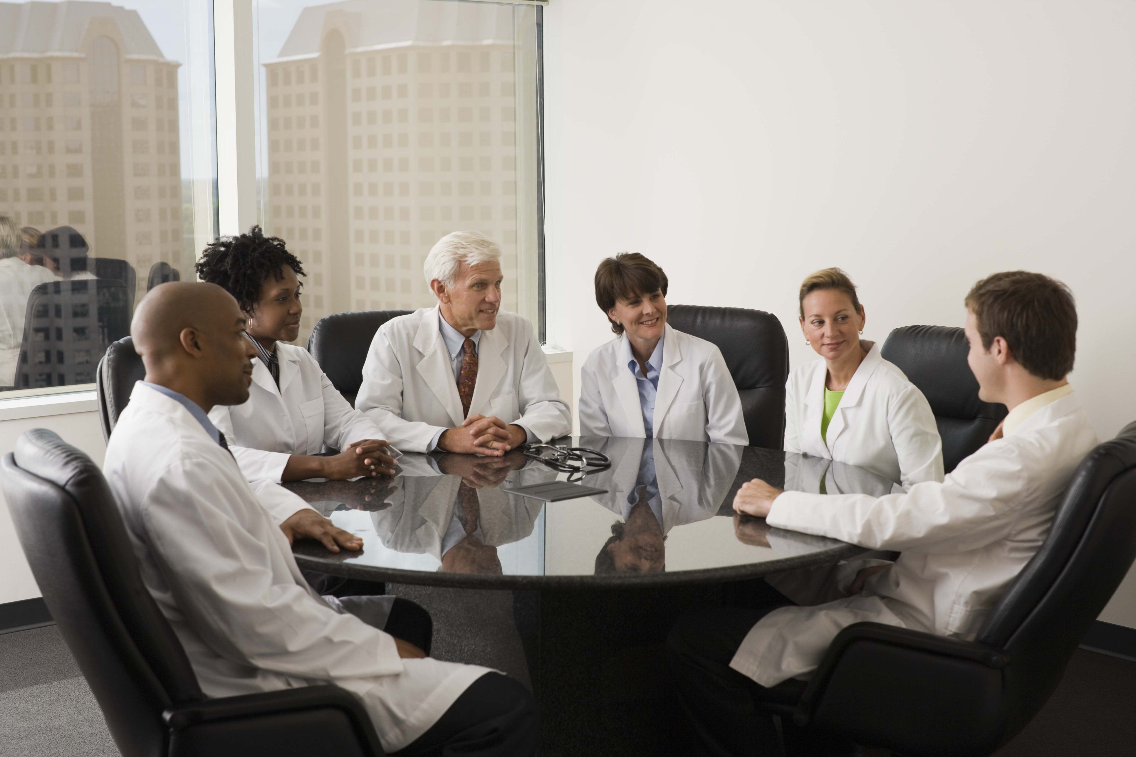 Doctors sitting at a conference table