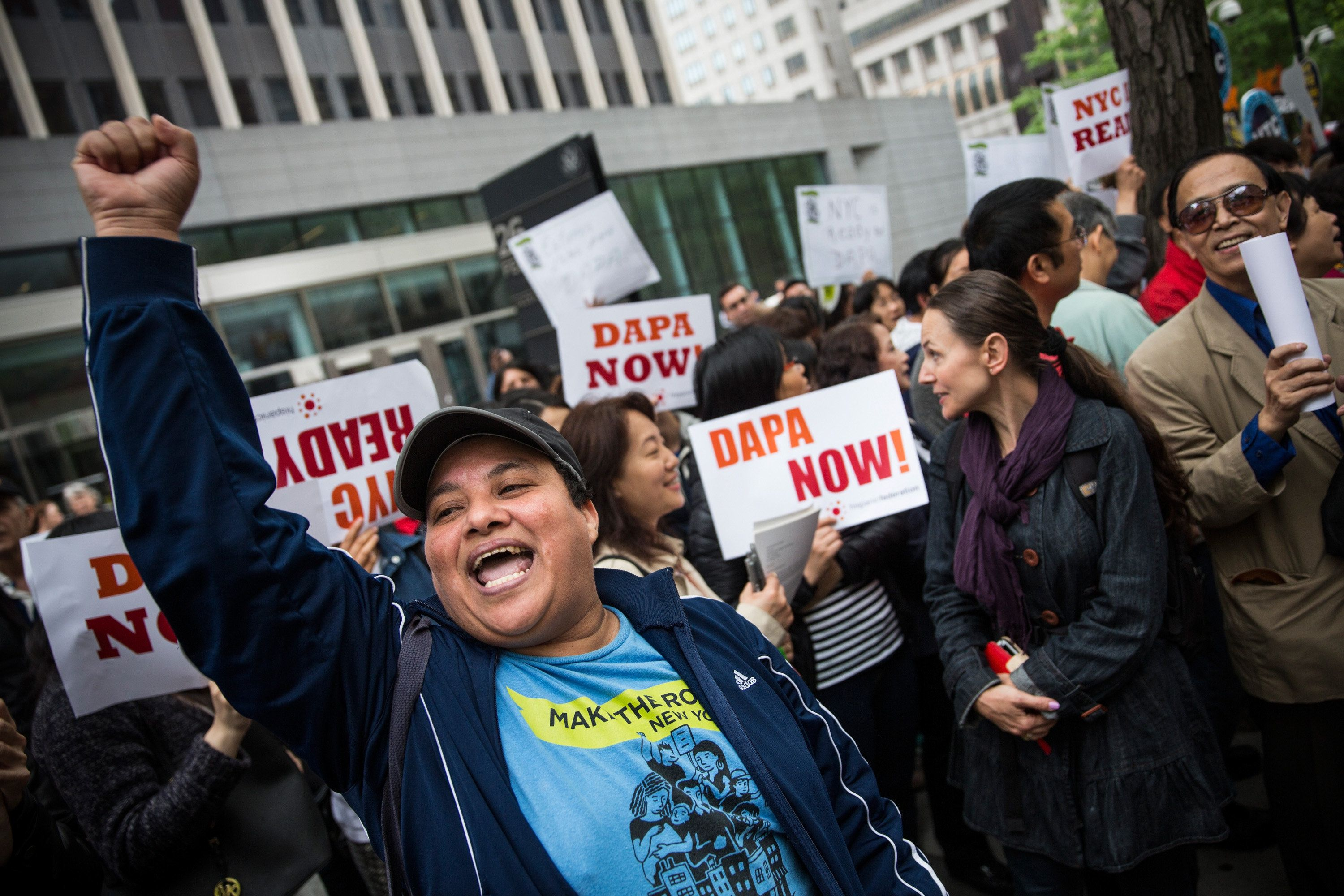 NEW YORK, NY - MAY 19:  Activists calling for federal judges to reject challenges to President Obama's 'Deferred Action for Parents of Americans and Lawful Permanent Residents' (DAPA) program protest outside the Jacob K. Javits Federal building, where naturalization ceremonies take place, on May 19, 2015 in New York City. DAPA, which has come under fire from conservatives, would create a system which would stop the deportation of certain immigrants who entered to U.S. illegally.  (Photo by Andrew Burton/Getty Images)