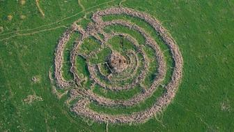 Rujm el-Hiri  is an ancient megalithic monument, consisting of concentric circles of stone with a tumulus at center. It is located in the Golan Heights, some 16 kilometres east of the eastern coast of the Sea of Galilee. The picture shows an aerial view of the archeological site. Photo by Itamar Grinberg.