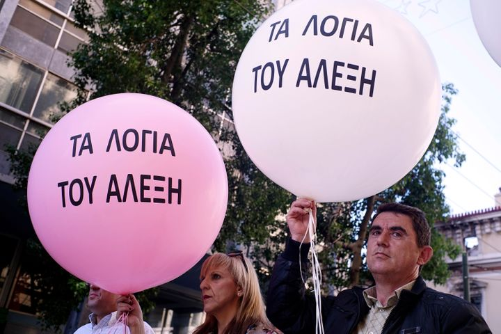 """Some demonstrators held pink balloons with """"The Promises of Alexis"""" written on them, suggesting the prime minister's words we"""