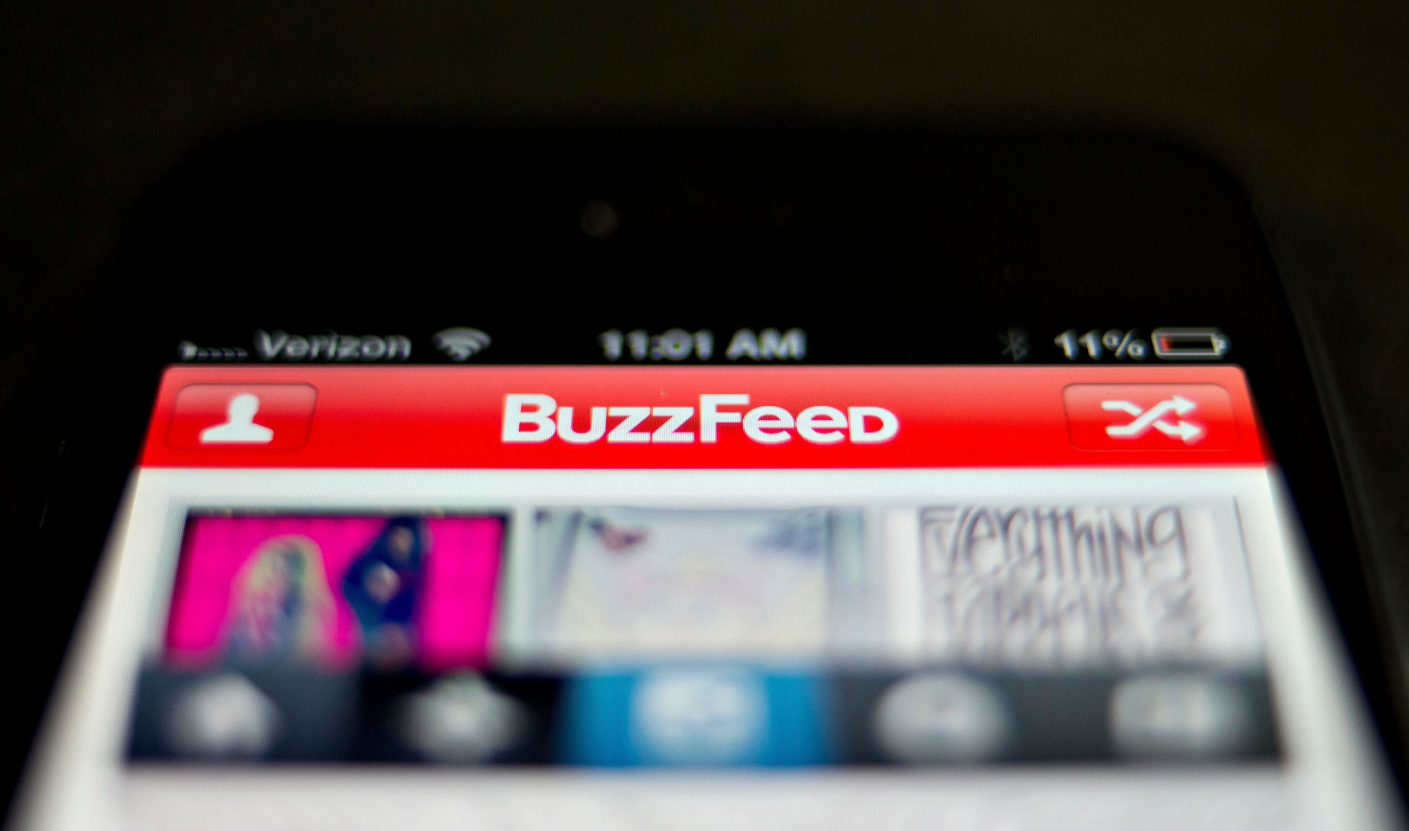 The BuzzFeed app is displayed on an Apple Inc. iPhone 5 in Tiskilwa, Illinois, U.S., on Thursday, May 30, 2013. New York Times Co., looking to imitate the business models used by startups such as BuzzFeed Inc., is considering letting advertisers sponsor more stories on its website, two people with knowledge of the situation said. Photographer: Daniel Acker/Bloomberg via Getty Images