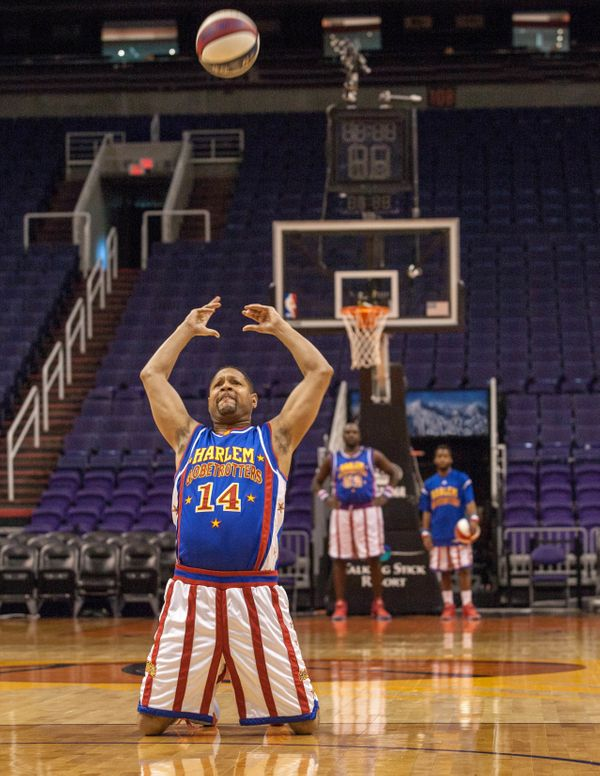 Handles Franklin of the Harlem Globetrotters is able to toss a basketball backward 60 feet, 7.5 inches -- while on his knees.