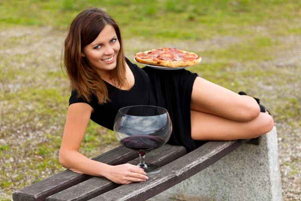 Not sure what's sexier here, the pizza or the comically large glass of red wine.