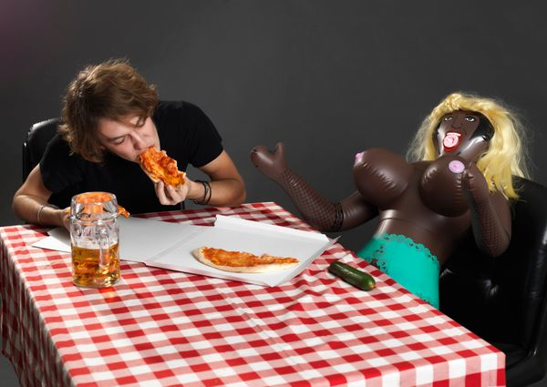 "This perplexing stock photo features one lucky man splitting some 'za with his ""mistress plastic"""