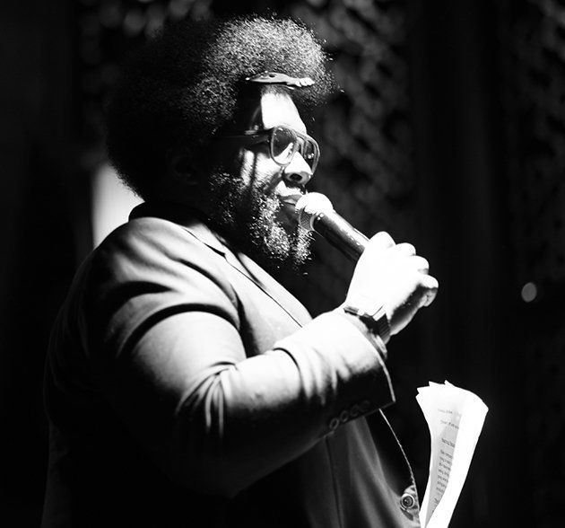 Questlove presents while reading from printed-speech.