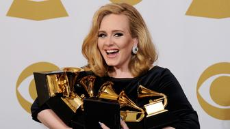 LOS ANGELES, CA - FEBRUARY 12:  Singer Adele, winner of the GRAMMYs for Record of the Year for 'Rolling In The Deep', Album of the Year for '21', Song of the Year for 'Rolling In The Deep', Best Pop Solo Performance for 'Someone Like You', Best Pop Vocal Album for '21' and Best Short Form Music Video for 'Rolling In The Deep', poses in the press room at the 54th Annual GRAMMY Awards at Staples Center on February 12, 2012 in Los Angeles, California.  (Photo by Kevork Djansezian/Getty Images)