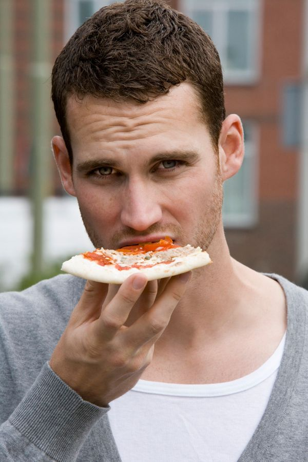 Is his smoldering gaze hotter than the slice in his hand? No, no it's not.