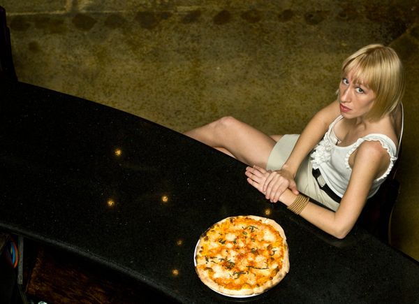 You're never dining alone when you're dining with pizza