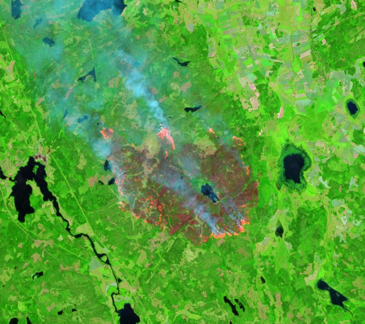 A shortwave infrared satellite image of the fire location on Aug. 4, 2014, in Sweden. The bright red/orange colors are showin