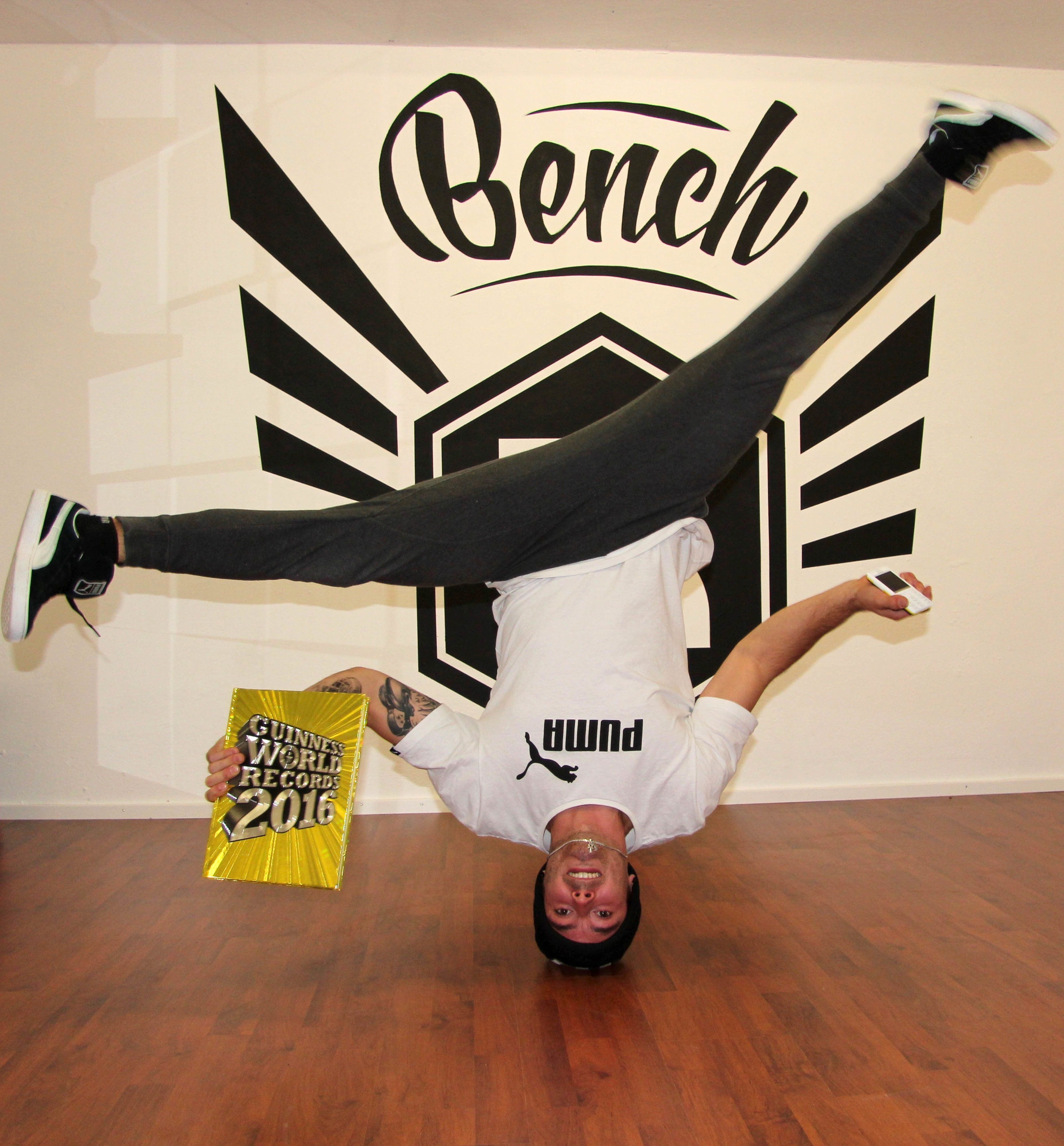 The fastest time to type a text message (SMS) on a mobile phone while performing head spins is 56.65 seconds and achieved by Benedikt Mordstein, in Freising, Bavaria, Germany, in celebration of Guinness World Records Day, on 12 November 2015