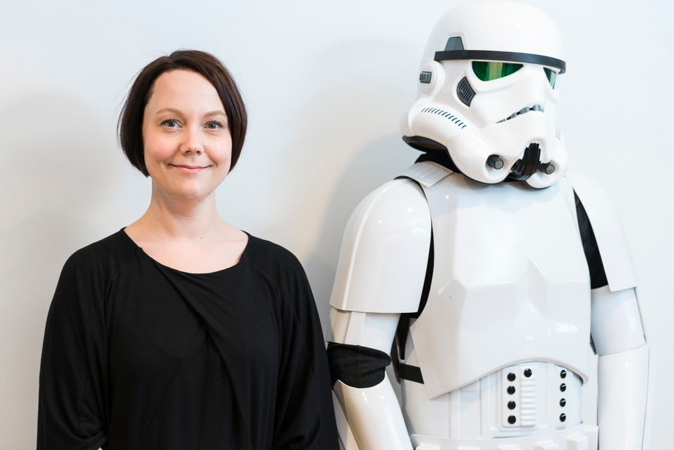 "Sigurlina Ingvarsdottir, lead producer of ""Star Wars Battlefront,"" chills with an Imperial stormtrooper."