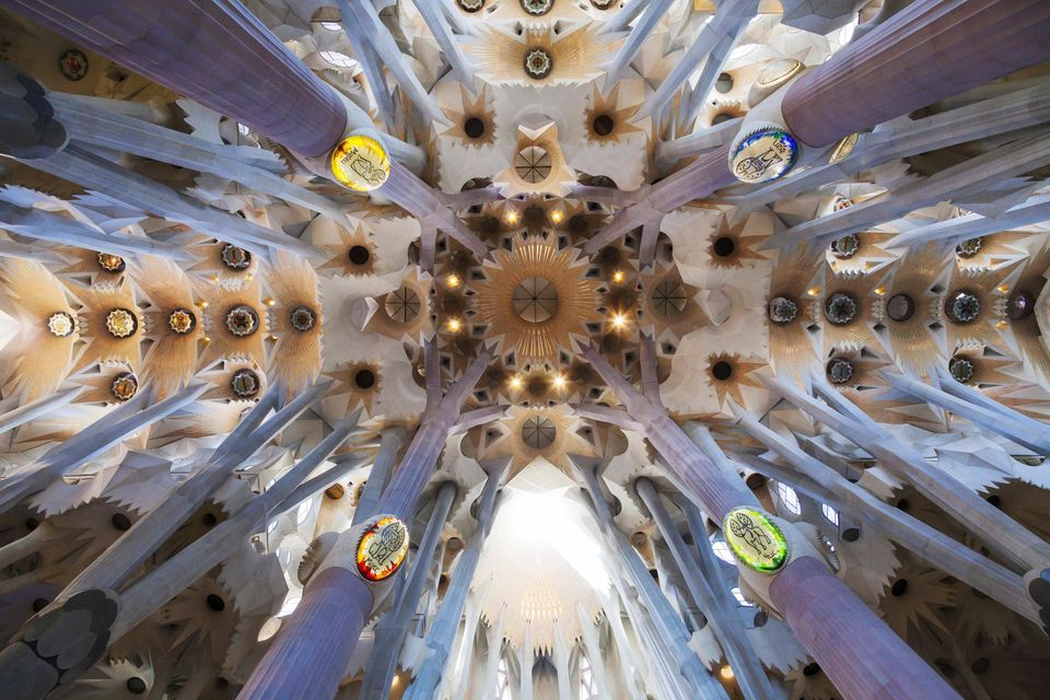 Thevaulted decorativeceiling of La Sagrada Familia cathedral in Barcelona, Spain.