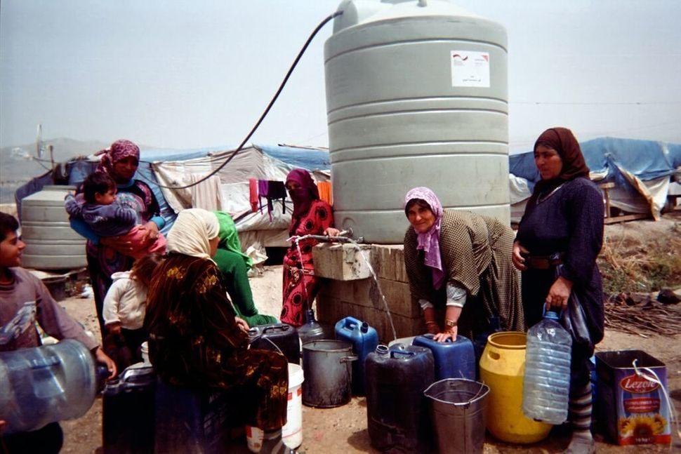 Shot by Riham, age 11<strong></strong>, from Homs Governorate, Syria.<strong><br></strong> Women accompanied by children fill
