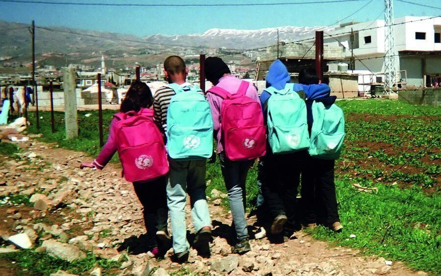 Shot by Ghazi, age 10<strong>, </strong>from al-Qasir, Syria.<strong><br></strong> A group of children walking to school