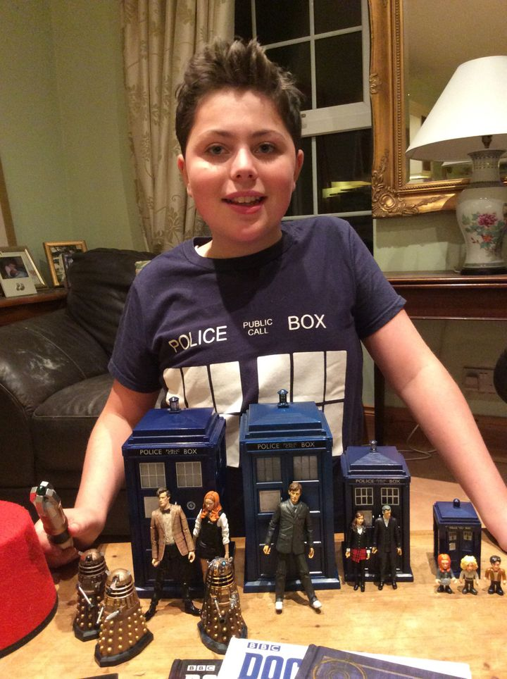 Rory displays his impressive Dr. Who toy collection.