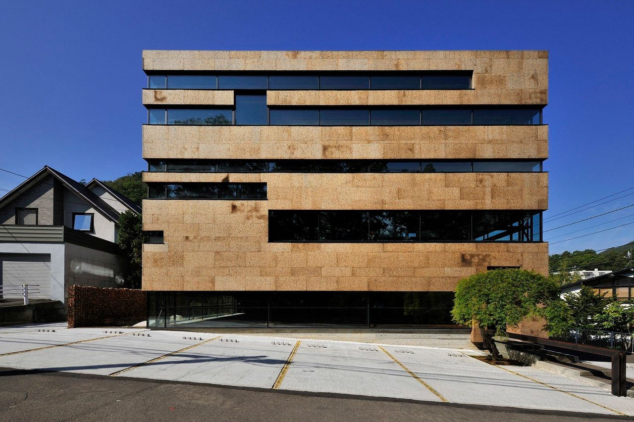 A completed office building in Sapporo, Hokkaido, in Japan that blends natural materials with minimalist style.