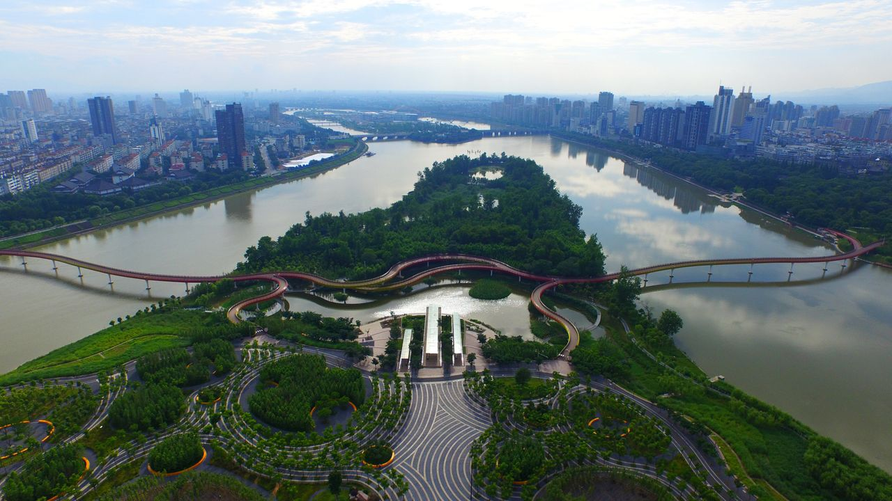 """The landscape of the year winner. """"Yanweizhou Park showcases a replicable and resilient ecological solution to large-scale flood management,"""" reads a statement for the project. """"Sitting at the mouth of three rivers, each over 100 meters wide, the Yanweizhou project uses groundbreaking strategy to create a water-resilient terraced river embankment that is covered with flood adapted native vegetation. The park's pedestrian paths and pavilions are integrated with the planting terraces, which adapt to seasonal flooding."""""""